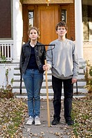 Teen brother and sister in American Gothic pose, Winnipeg, Canada
