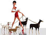Side profile of a woman walking with her dogs