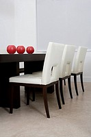 Decorative urns on a dining table in a dining room