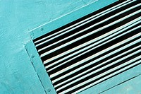 Close-up of an air duct on a wall