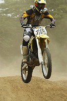 Motocross rider performing a jump on a motorcycle