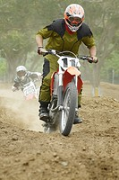 Motocross riders riding motorcycles