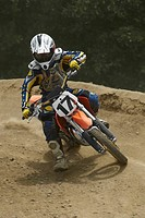 Motocross rider leaning into a turn