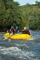 Five people rafting in a river (thumbnail)