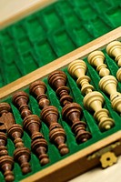 Close-up of chess pieces in a wooden box