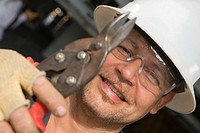 Close-up of a male construction worker holding a cutting tool