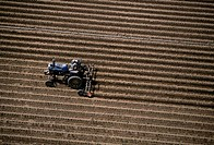 Aerial, plowing farm field