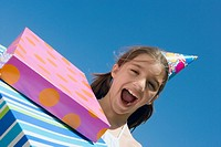 Portrait of a girl laughing with birthday presents