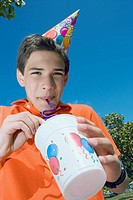 Low angle view of a boy drinking with a drinking straw