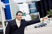 Businessman hailing a vehicle