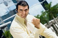 Portrait of a businessman making a fist and looking excited