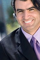 Portrait of a businessman wearing a hands free device and smiling