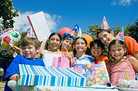 Group of children celebrating a birthday party (thumbnail)