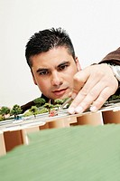 Close-up of a businessman looking at an architectural model in an office