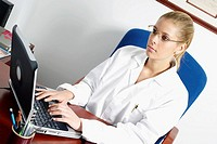 Close-up of a female doctor using a laptop