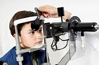 Close-up of a boy having an eye exam