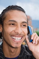 Close-up of a young man talking on a mobile phone (thumbnail)