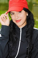 Portrait of a young woman wearing a baseball cap