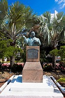 Bust on a pedestal in front of trees, Sir Milo Boughton Butler, Rawson Square, Nassau, Bahamas
