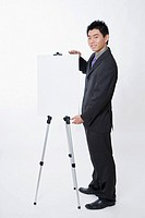 Businessman with presentation board