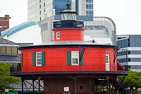 Lighthouse in front of buildings, Seven Foot Knoll Lighthouse, Inner Harbor, Baltimore, Maryland, USA