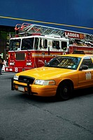 Fire engine and a yellow taxi on a road, New York City, New York State, USA