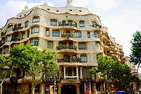 Trees in front of a building, La Pedrera, Barcelona, Spain
