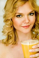 Portrait of a Women Holding a Glass of Orange Juice