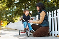 Mother with Son on a Tricycle in Autumn, Brampton, Ontario