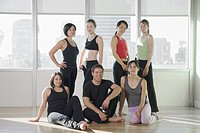 Group of Dancers or Yoga Students in a Gym