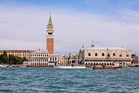 Boat docked near a tower, Bell Tower, St  Mark's Square, Venice, Italy