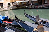 Gondolas docked in a canal, Venice, Italy