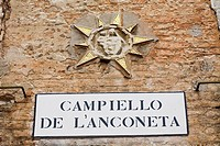 Close-up of a nameplate on a brick wall, Venice, Italy