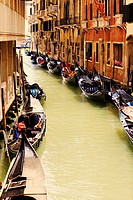 Gondolas docked on both sides of a canal, Venice, Italy
