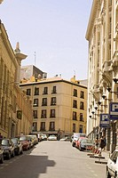 Cars parked on the street in front of buildings, Madrid, Spain