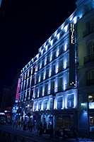 Low angle view of a hotel lit up at night, Madrid, Spain
