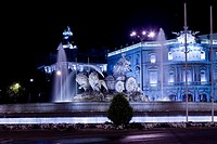 Fountain in front of a palace lit up at night, Cibeles Fountain, Palacio de Linares, Plaza de Cibeles, Madrid, Spain