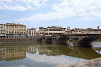 Reflection of an arch bridge in water, Ponte Santa Trinita Bridge, Arno River, Florence, Italy