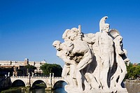 Close-up of statues in front of an arch bridge, Ponte Sant Angelo, Tiber River, Rome, Italy