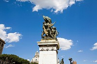 Low angle view of statues on the pedestal, Rome, Italy