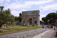 Tourists near a triumphal arch, Arch Of Constantine, Rome, Italy