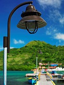 Close-up of a lamppost with mountains in the background, Lovebird's Bridge, Providencia, Providencia y Santa Catalina, San Andres y Providencia Depart...