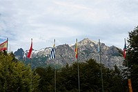 Flags and trees in front of mountains, San Carlos De Bariloche, Argentina