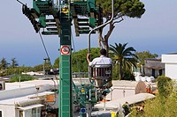 Rear view of a man sitting in an overhead cable car, Capri, Campania, Italy