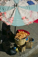 High angle view of a man selling breads, Vientiane, Laos