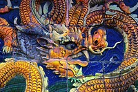 Close-up of a Chinese dragon carved on a wall, Beijing, China