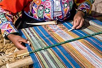 Mid section view of a woman weaving in a loom, Aguanacancha, Peru