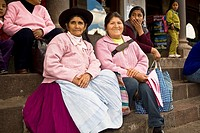 Portrait of a senior woman with a mid adult woman sitting on steps, Peru