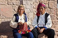 Portrait of two senior men sitting together, Taquile Island, Lake Titicaca, Puno, Peru