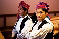 Close-up of two young men taking part in a wedding ceremony, Taquile Island, Lake Titicaca, Puno, Peru